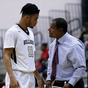 Marshall Reed #11 listens to Westfield Head Coach Doug Ewell in a game with Herndon HS. Reed led all scoreres with22 points in Westfield's 61-55 win.