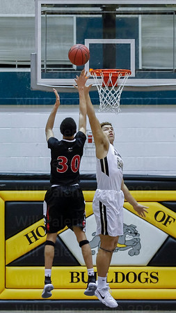 Herndon's Corey Myers #30 releases a shot while Westfield's Chris Weaver #24 defends
