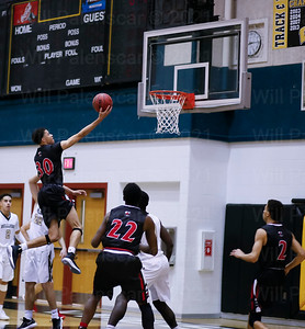 Corey Myers #30 glides to the hoop. Myers scored 14 points to lead Herndon.