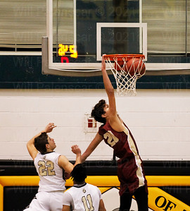 Braeden Johnson #20 slams in two of his points with Westfield.