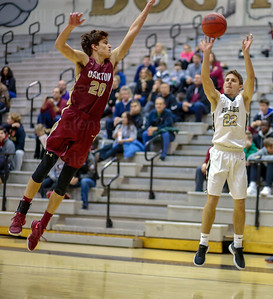 Taylor Morin #22 succesfully gets  this 3 pointer off while Braeden Johnson #20 defends in game with Oakton