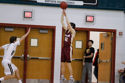 Jake Digby #32 fires a jump shot before Gavin Kiley can get to the ball