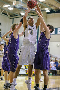 Westfield's Cris Scruggs #20 scores two of his 6 points while Jon Tammaro #34 and Christian Parana #3 defend