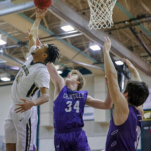 Marshall Reed #11 tries to grab a  offensive rebound for Westfield