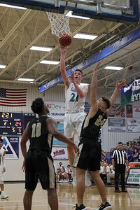 Will Rowe #21 puts up a shot over Westfield defenders