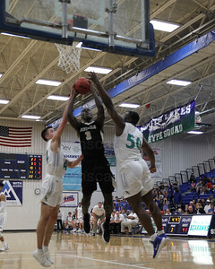 Aaron Opoku #3 is fouled as he takes the ball to the rim.