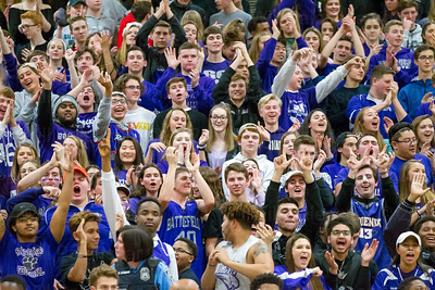 Battlefield HS students cheer towards the end of their teams victory over Madison
