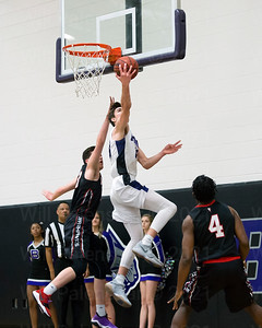 Will Bounds  #23 reverses a layup attempt
