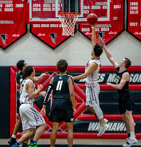 Madison's Max Johnson #21  takes the ball to glass in the Concorde District 1st round matchup with Westfield