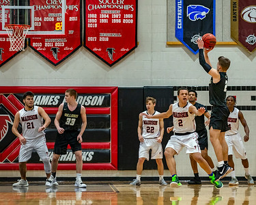 Taylor Morin #2 fires a jump shot in his teams 48-42 victory over Madison. Morin would score 6 points including 4 of 4 free thrown in the final quarter.