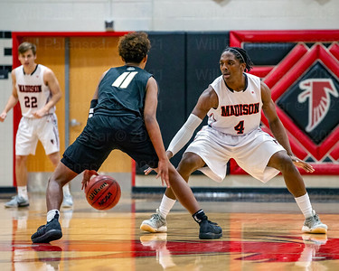 Tahj Summey #11 dribbles the ball between his legs as John Finney #4 guards him closely
