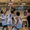 Marshall Reed #3 easily elevates over two Centreville defenders
