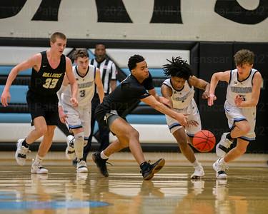 Marshall Reed #3 and Bryce Douglas #1 battle for a loose ball