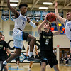 Gavin Kiley #5  has the attention of two Centreville defenders