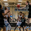 Sam Johnson #33 exteends to gain control of a loose ball