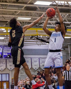 Centreville's Bryce Douglas #1 led Centreville with 22 points in win over Oakton