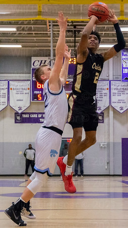 Oakton's Micah Johnson - Parotte #2 led all scorers with 33 points in his teams loss to Centreville in the Concorde District Championship .