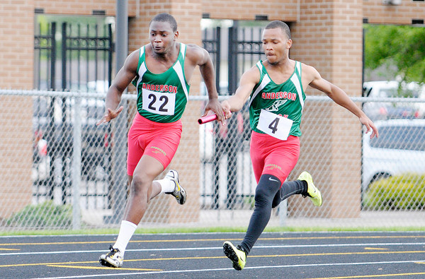 Don Knight | The Herald Bulletin<br /> Anderson's Parker Jones hands the baton to Ben Shepherd during the 4 by 100 meter relay during the Boys Track Sectional at Mt. Vernon on Thursday.