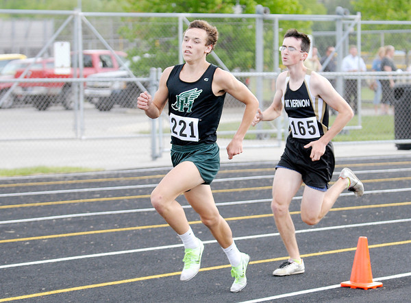 Don Knight | The Herald Bulletin<br /> Pendleton Heights' Eli Young passes Mt. Vernon's Aaron Rush during the 1600 meter run during the Boys Track Sectional at Mt. Vernon on Thursday.