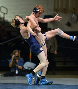 North's Jake Potter takes Zack Trampe to the mat.