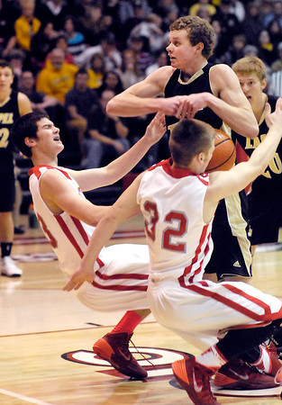 As Lapel's Mitchell Richardson fights for the rebound he collides with Frankton's Brady Ashton and Nick Wright knocking them down.