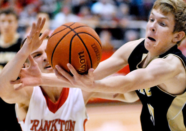 Frankton's Nick Wright and Lapel's Kamron Herrington fight after the loose ball.