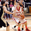 Frankton's Austin Compton tries to drive the lane between Lapel defenders.