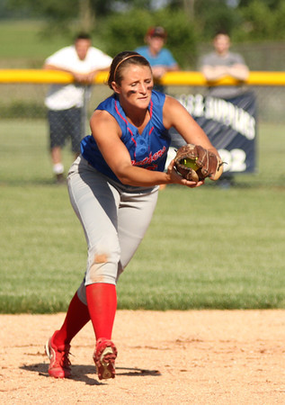 Photo by Chris Martin<br /> Elwood's Tenasha Stephens cathes a line drive at second base Tuesday as the Panthers win the regional championship by defeating the Raiders 9-0