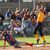 Photo by Chris Martin<br /> Elwood's Jessie Noone slides safely back to third base in a rundown Tuesday in a regional championship win against Shenandoah