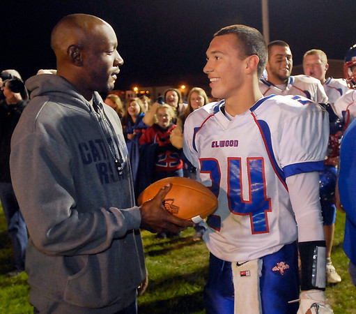 Former Mr. Football Indianapolis Cathedral running back Otis Shannon congratulates Elwood's running back Sammy Mireles after Mireles broke Shannon's all time state career rushing record of 7,560 yards in the third quarter Friday evening against Alexandria.