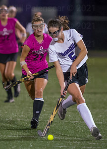 Hannah Reeves #5 moves the ball down the field  as Westfields Delaney Golian #27 gives chase