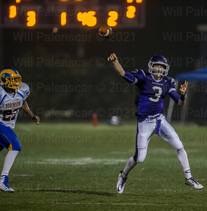 Chantilly QB #3 David Tammaro, avoids the rush by throwing the ball down the field