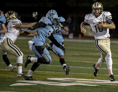 Tyler Scanlon #10  keeps the the ball away from the oppoisng Centreville defense