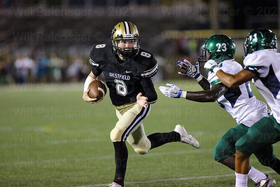 Cole Huling #8 looks tries to avoid the South County defense.