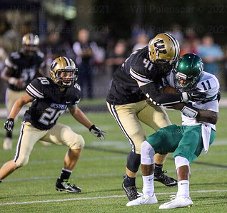 Westfields Jack Clancy #41 holds on to South county QB Deandre Clayton #11.