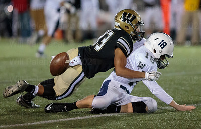 Jose Perdomo knocks the ball from W-L quaterback Andrew Malone. Perdomos teammate Jonathan Aiello  would pick the ball up and run in for a Westfield TD