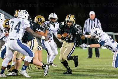 Tim Beard tries to avoid defenders in Westfields regional playoff victory. Beard carried the ball for 140 yards and 2 TDs