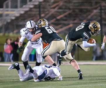 Westfield Tyler Scanlon is airborne after being tripped up by a Washington-Lee defender