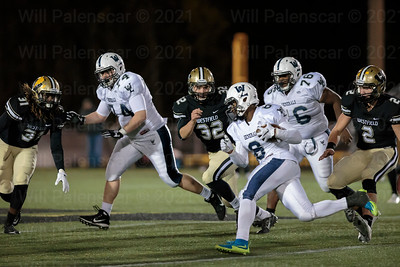 W-L Evan Craige #8 looks for room to run against the Westfield defense of Terrell Monticue #31 and Kevin Petrillo # 32