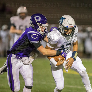 Chantillys Hunter Streb #1 attempts to strip the ball from Stone Bridge QB Mason Tatum #12