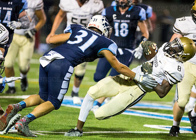 Westfield's Eugene Asante #5 carries the ball against Stone Bridge