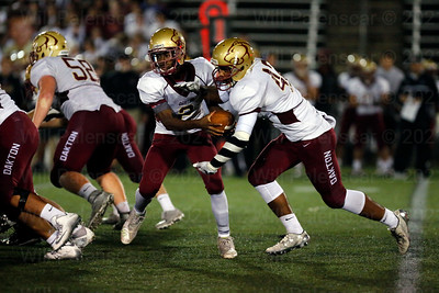Oakton QB Ahmad #2 hands the ball off to Lindsey Elias#42