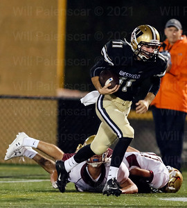 Westfield's Spencer Burns #11 leaves two Oakton defenders in the turf on this 3 yard TD
