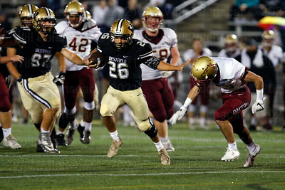 Nathaniel Chung pushes off Oakton defender on way to a 28 yard TD run