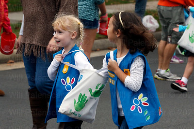 Two of the Girl Scouts share a bag of candy to give to spectators during the Westfield Homecming Parade 2016