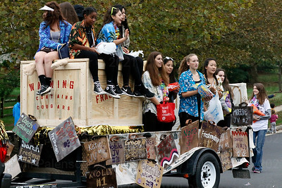 Westfield Students give candy out to parade watchers, while they appear to have the Oakton  Cougars in a crate before the Homecoming Game wih Oakton