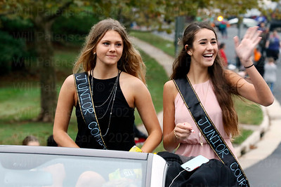 Members of the Junior Court during the 2016 Homecoming Parade offer fiendly smiles and wave to the spectators