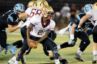 Oakton QB Ahmad Shaw #2 prepares tooo pitch the ball to teammate. Shaw completed 10 - 20 passes for 102 yards.
