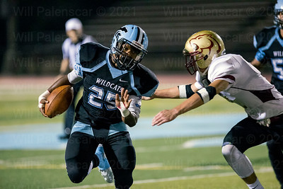 Deonte Edmonds rushes the ball against Oakton. Edmonds carried the ball 9 times for 68 yards and a TD