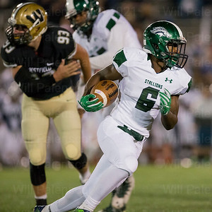 Solomon Simay #6 runs for positive yardage in a 6A North 2nd round playoff game